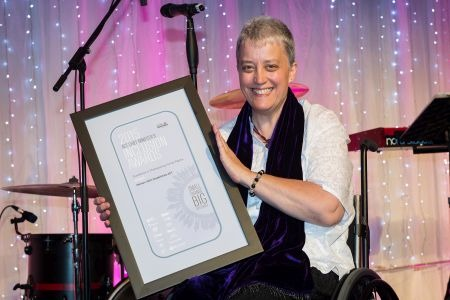 Director Lou Bannister accepts the 2015 Chief Minister's Inclusion Award for WWDACT